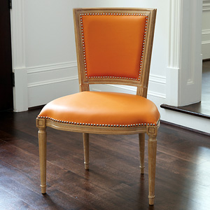 Dining chair no arms with orange leather nomadic decorator